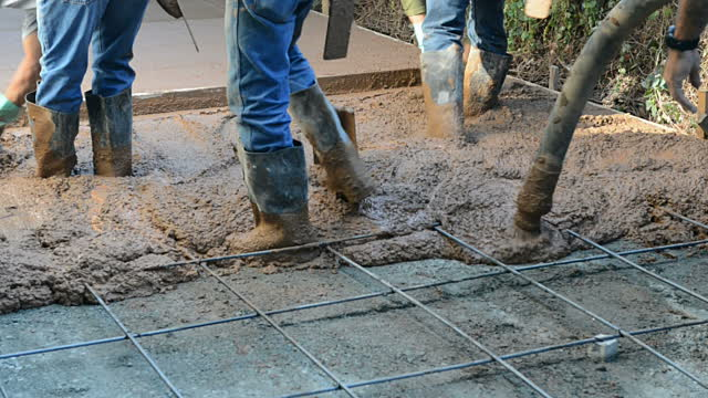 Nice video! Booted workers in cement!